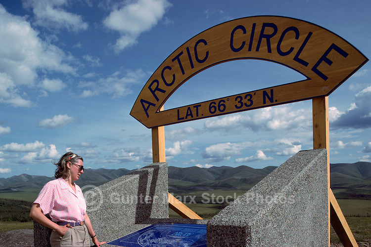 Tourist at Arctic Circle, along Dempster Highway (Hwy 5), Yukon Territory, YT, Canada (Model Released)
