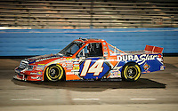 Nov. 13, 2009; Avondale, AZ, USA; NASCAR Camping World Truck Series driver Rick Crawford during the Lucas Oil 150 at Phoenix International Raceway. Mandatory Credit: Mark J. Rebilas-