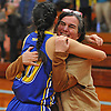 Eileen Calabro hugs her daughter, Kellenberg varsity girls basketball player Clare Calabro #10 after she hit a long-range three-pointer at the buzzer to lift the Lady Firebirds to a dramatic 48-47 win over host Our Lady of Mercy Academy in a CHSAA league game on Friday, Jan. 13, 2017.