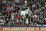 28 May 2008: Oguchi Onyewu (USA) (22) heads the ball while being challenged by Wayne Rooney (ENG) (11). The England Men's National Team defeated the United States Men's National Team 2-0 at Wembley Stadium in London, England in an international friendly soccer match.