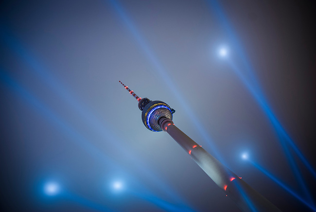The TV tower Berlin at the festival of light. Shot on a misty night  to show the light beams