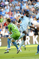 Kei Kamara (23) midfielder Sporting KC gets the better of Jeff Parke (31) defender Seattle Sounders....... Sporting Kansas City were defeated 1-2 by Seattle Sounders at LIVESTRONG Sporting Park, Kansas City, Kansas.