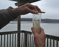 NWA Media/Michael Woods --12/19/2014-- w @NWAMICHAELW...Russell Rhodes, a retired scientist, examines an algae sample from Lake Fayetteville Friday afternoon.   Rhodes who specializes in algae, helps monitor the algae levels in the lakes around Northwest Arkansas.