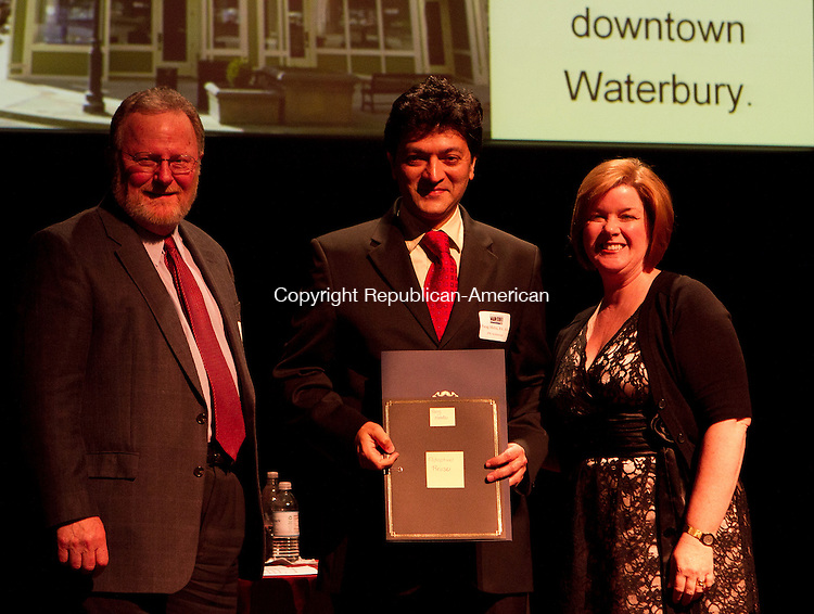 Torrnington, CT-06 June 2011-060611JH03- John Simone, (left) president&ceo of Connecticut Main Street Center and Kimberley Parsons-Whitaker(right) present the Award of Excellence for Adaptive Reuse of a Building to Parag Mehta (middle) of The Hodson Building in Downtown Waterbury during the Connecticut Main Street Awards Gala in Nancy Marine Studio Theatre Monday afternoon in Torrington.   Junfu Han Republican-American
