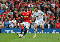 Pictured L-R: Nani of Manchester United against Angel Rangel of Swansea. Saturday 16 August 2014<br />