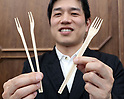 "March 9 2017, Tokyo, Japan - Jun Takagi, London based product designer displays a wooden fork which can transform to a pair of chopsticks ""Split Fork & Chopsticks"" at a presentation of All Nippon Airways (ANA) crowdfunding ""WonderFLY"" in Tokyo on Thursday, March 9, 2017. ANA launched crowdfunding platform from last year and they announced award winning unique products.    (Photo by Yoshio Tsunoda/AFLO) LwX -ytd-"