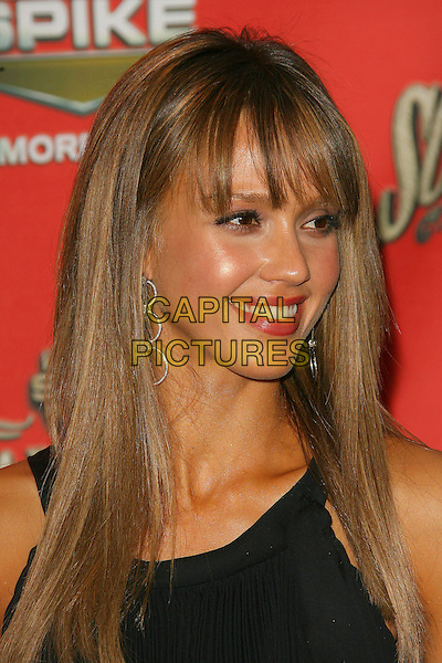 "JESSICA ALBA.Spike TV Presents ""Scream Awards 2006"" - Arrivals .held at Pantages Theater, Hollywood, California, USA,.7 October 2006..portrait headshot fringe black layered dress hoop earrings .Ref: ADM/ZL.www.capitalpictures.com.sales@capitalpictures.com.©Zach Lipp/AdMedia/Capital Pictures."