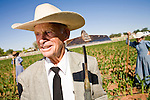"""June 16, 2008 -- COLORADO CITY, AZ: JOSEPH JESSOP, 86 years old, with members of his family take a break from weeding the family corn plot in Colorado City, AZ. Jessop, a veteran of World War II, a polygamist and member of the FLDS, was arrested during the Short Creek Raid in 1953 and had his wives and children taken from him for two years. Jessop still weeds his fields by hand and makes the hoes used in the community. He make 250-300 hoes every winter for use in the summer growing season. Colorado City and neighboring town of Hildale, UT, are home to the Fundamentalist Church of Jesus Christ of Latter Day Saints (FLDS) which split from the mainstream Church of Jesus Christ of Latter Day Saints (Mormons) after the Mormons banned plural marriage (polygamy) in 1890 so that Utah could gain statehood into the United States. The FLDS Prophet (leader), Warren Jeffs, has been convicted in Utah of """"rape as an accomplice"""" for arranging the marriage of teenage girl to her cousin and is currently on trial for similar, those less serious, charges in Arizona. After Texas child protection authorities raided the Yearning for Zion Ranch, (the FLDS compound in Eldorado, TX) many members of the FLDS community in Colorado City/Hildale fear either Arizona or Utah authorities could raid their homes in the same way. Older members of the community still remember the Short Creek Raid of 1953 when Arizona authorities using National Guard troops, raided the community, arresting the men and placing women and children in """"protective"""" custody. After two years in foster care, the women and children returned to their homes. After the raid, the FLDS Church eliminated any connection to the """"Short Creek raid"""" by renaming their town Colorado City in Arizona and Hildale in Utah.   Photo by Jack Kurtz"""