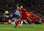 Lewis Dunk of Brighton stops Virgil van Dijk of Liverpool from scoring his hat-trick during the Premier League match at Anfield, Liverpool. Picture date: 30th November 2019. Picture credit should read: Simon Bellis/Sportimage