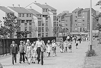 Making their way to the Education Centre, Festival & Gala Day, Wester Hailes, Scotland, 1979.  John Walmsley was Photographer in Residence at the Education Centre for three weeks in 1979.  The Education Centre was, at the time, Scotland's largest purpose built community High School open all day every day for all ages from primary to adults.  The town of Wester Hailes, a few miles to the south west of Edinburgh, was built in the early 1970s mostly of blocks of flats and high rises.