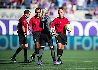 Orlando, Florida - Sunday, May 8, 2016: The referee speaks to Orlando Pride goalkeeper Ashlyn Harris (1) during a National Women's Soccer League match between Orlando Pride and Seattle Reign FC at Camping World Stadium.