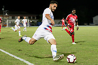 GEORGETOWN, GRAND CAYMAN, CAYMAN ISLANDS - NOVEMBER 19: Cristian Roldan #10 of the United States sends a ball downfield during a game between Cuba and USMNT at  Truman Bodden Sports Complex on November 19, 2019 in Georgetown, Grand Cayman.