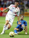 09 July 2006: Willy Sagnol (FRA) (19) keeps Simone Perrotta (ITA) (20) off the ball. Italy tied France 1-1 in overtime at the Olympiastadion in Berlin, Germany in match 64, the championship game, of the 2006 FIFA World Cup Finals. Italy won the World Cup by defeating France 5-3 on penalty kicks.