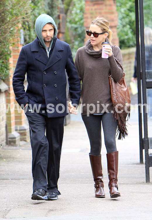 **ALL ROUND PICTURES FROM SOLARPIX.COM**                                             **WORLDWIDE SYNDICATION RIGHTS**                                                                                  Caption: Hollywood actors Matt Bellamy & Kate Hudson Seen out in North London                                                                                                                                                                         JOB REF: 14550       WMB       DATE: 09.03.2012                                                           **MUST CREDIT SOLARPIX.COM OR DOUBLE FEE WILL BE CHARGED**                                                                      **MUST AGREE FEE BEFORE ONLINE USAGE**                               **CALL US ON: +34 952 811 768 or LOW RATE FROM UK 0844 617 7637**