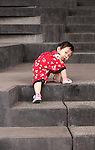 Climber 01 - Young Chinese girl climbing the concrete steps of the School Of The Arts (SOTA), Singapore