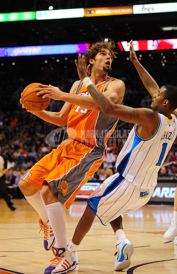 Dec. 26, 2011; Phoenix, AZ, USA; Phoenix Suns guard Robin Lopez controls the ball during game against the New Orleans Hornets at the US Airways Center. The Hornets defeated the Suns 85-84. Mandatory Credit: Mark J. Rebilas-USA TODAY Sports