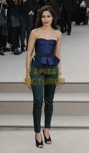 Freida Pinto.attended the Burberry Prorsum London Fashion Week a/w 2013 catwalk show, Kensington Gardens, Hyde Park, London, England..February 18th, 2013.LFW full length blue strapless top peplum green trousers black open toe shoes .CAP/CAN.©Can Nguyen/Capital Pictures.