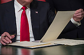 United States President Donald Trump formally signs his cabinet nominations into law, Friday, Jan. 20, 2107, in the President's Room of the Senate on Capitol Hill in Washington, Friday, Jan. 20, 2017. <br /> Credit: J. Scott Applewhite / Pool via CNP