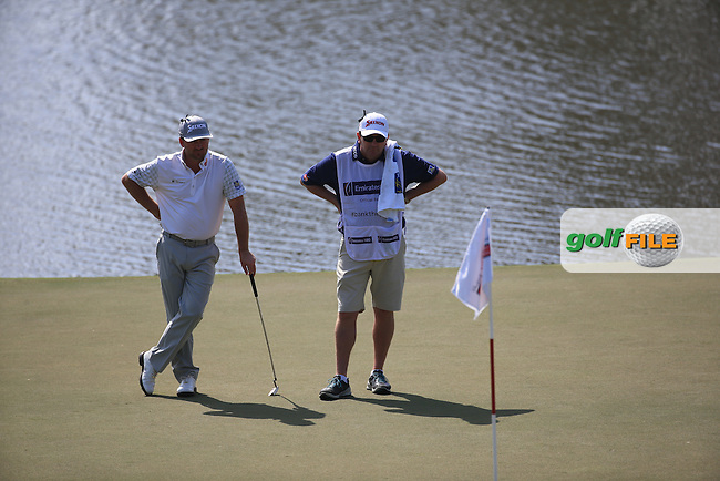 Graeme McDowell (NIR) with caddie Ken Comboy on the 7th green during Round One of the 2016 Omega Dubai Desert Classic, played on the Emirates Golf Club, Dubai, United Arab Emirates.  04/02/2016. Picture: Golffile | David Lloyd<br /> <br /> All photos usage must carry mandatory copyright credit (&copy; Golffile | David Lloyd)