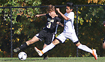 BEACON FALLS  CT. - 15 October 2019-101519SV14- #3 Sean Hussey of Woodland High tries to keep the ball from #17 Aristotle York of Oxford High during NVL soccer action in Beacon Falls Tuesday.<br />Steven Valenti Republican-American