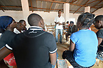 Members of a youth sexual and reproductive health club gather for a meeting in a church in Emanyeleni, Malawi. With assistance from the AIDS program of the Livingstonia Synod of the Church of Central Africa Presbyterian, club members educate their peers about avoiding HIV transmission, resisting early marriages, and the prevention of early school dropouts.
