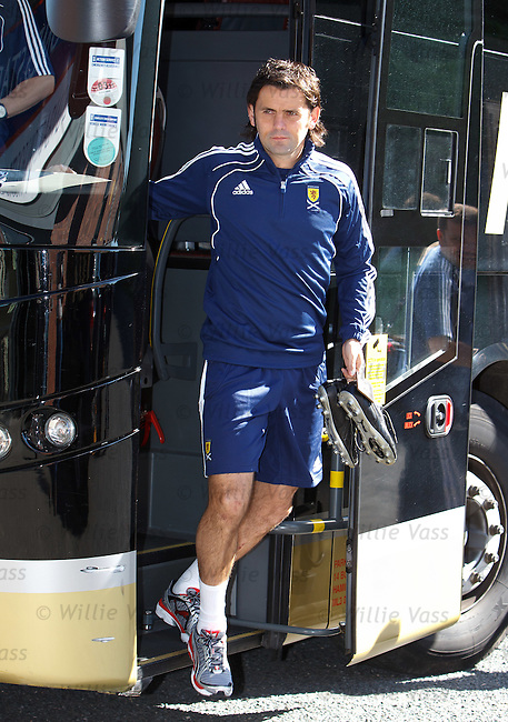 Paul Hartley steps off the SCotland team bus for training