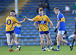 Thomas Kelly and Shane Meehan of Clare celebrate a point by the latter during their Munster Minor football semi-final against Tipperary at Thurles. Photograph by John Kelly.