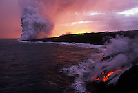 Coastal view of lava meeting the Pacific Ocean and releasing vapour
