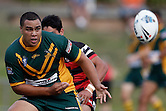 Leivaha Pulu of the Wyong Roos cpasses the ball during the first trail game of the 2013 NSW Cup season against the North Sydney Bears at Morrie Breen Oval on February 9, 2013 in Wyong, Australia. (Photo by Paul Barkley/LookPro)