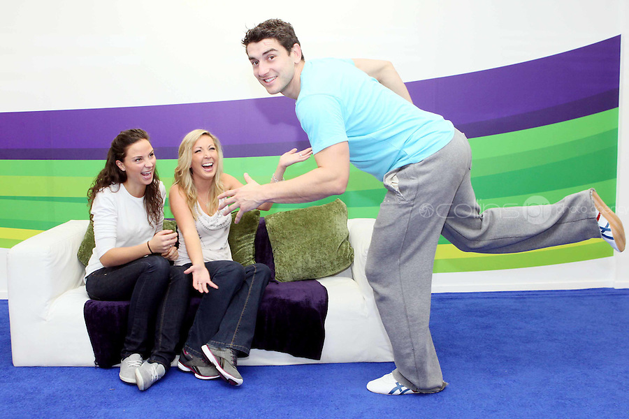 """NO REPRO FEE. Bernard Brogan, GAA All Star and 2010 Footballer of the Year with Linda O Neill and Aishling O Reilly , popped into the Kinect Experiential Centre on Grafton Street to get a sneak preview of Kinect ahead of launch on November 10thand take on the public in a series of sprints as part of a """"Kinect Sports"""" challenge.Kinect for Xbox 360 makes it possible to play in a whole new way by identifying your movement and body position to create a truly immersive entertainment experience. See a ball? Just kick it. Browse through a menu with the wave of a hand Picture James Horan/Collins Photos"""