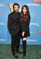 LOS ANGELES, CA - MARCH 06: Actor Sharlto Copley (L) and model/actress Tanit Phoenix attend the world premiere of 'Gringo' from Amazon Studios and STX Films at Regal LA Live Stadium 14 on March 6, 2018 in Los Angeles, California.<br /> CAP/ROT/TM<br /> &copy;TM/ROT/Capital Pictures
