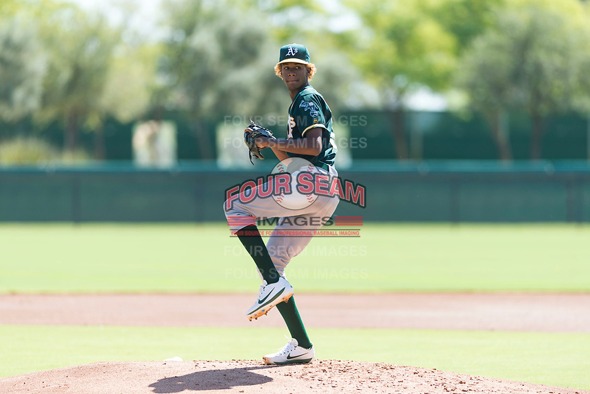 Oakland Athletics relief pitcher Wilkin Ramos (50) delivers a pitch during an Instructional League game against the Los Angeles Dodgers at Camelback Ranch on September 27, 2018 in Glendale, Arizona. (Zachary Lucy/Four Seam Images)
