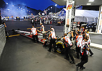 Jun. 15, 2012; Bristol, TN, USA: Crew members push the car of NHRA top fuel dragster driver David Grubnic during qualifying for the Thunder Valley Nationals at Bristol Dragway. Mandatory Credit: Mark J. Rebilas-