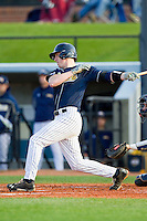 TJ Spina (9) of the UNCG Spartans follows through on his swing against the Georgia Southern Eagles at UNCG Baseball Stadium on March 29, 2013 in Greensboro, North Carolina.  The Spartans defeated the Eagles 5-4.  (Brian Westerholt/Four Seam Images)
