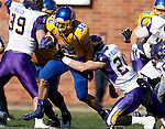 BROOKINGS, SD - OCTOBER 24:  Kyle Paris #32 from South Dakota State tries to break the grasp of Tim Kilfoy #24 from University of Northern Iowa in the first quarter of their game Saturday afternoon at Coughlin Alumni Stadium in Brookings. (Photo by Dave Eggen/Inertia)