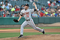 Mike Kickham (52) of the Fresno Grizzlies delivers a pitch to the plate against the Salt Lake Bees at Smith's Ballpark on May 25, 2014 in Salt Lake City, Utah.  (Stephen Smith/Four Seam Images)