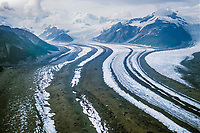 Aerial view of Long glacier with multiple medial moraines (black lines of rock in the glacier) Wrangell St. Elias National Park, Alaska.