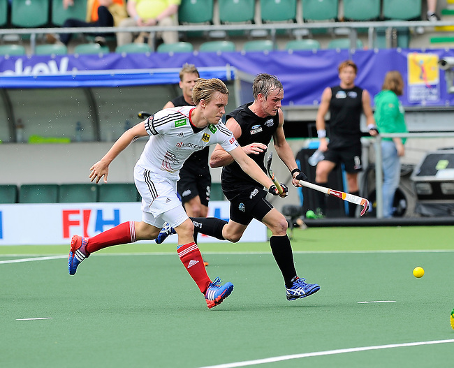 The Hague, Netherlands, June 08: Hugo Inglis #29 of New Zealand fights for the ball with Linus Butt #3 of Germanyduring the field hockey group match (Men - Group B) between the Black Sticks of New Zealand and Germany on June 8, 2014 during the World Cup 2014 at Kyocera Stadium in The Hague, Netherlands. Final score 3-5 (1-3) (Photo by Dirk Markgraf / www.265-images.com) *** Local caption ***