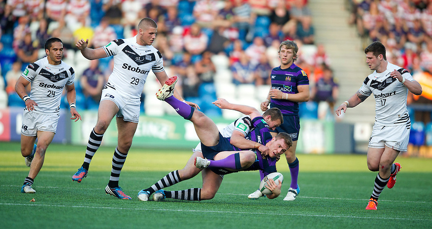 Wigan Warriors' Scott Taylor is tackled by Widnes Vikings' Steve Pickersgill <br /> <br />  (Photo by Stephen White/CameraSport) <br /> <br /> Rugby League - Super League - Widnes Vikings v Wigan Warriors - Friday  7th June 2013 - Stobart Stadium - Halton<br /> <br /> &copy; CameraSport - 43 Linden Ave. Countesthorpe. Leicester. England. LE8 5PG - Tel: +44 (0) 116 277 4147 - admin@camerasport.com - www.camerasport.com