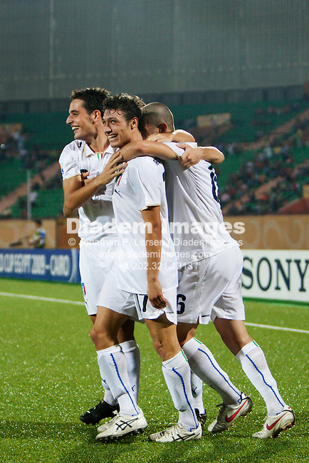 CAIRO - OCTOBER 5:  Italy players celebrate a goal by Mattia Mustacchio (C) during the FIFA U-20 World Cup round of 16 match against Spain at Al Salam Stadium on October5, 2009 in Cairo, Egypt.  Editorial use only.  Commercial use prohibited.  (Photograph by Jonathan P. Larsen)