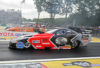 Jun. 1, 2012; Englishtown, NJ, USA: NHRA funny car driver Blake Alexander (near lane) races alongside Todd Lesenko during qualifying for the Supernationals at Raceway Park. Mandatory Credit: Mark J. Rebilas-
