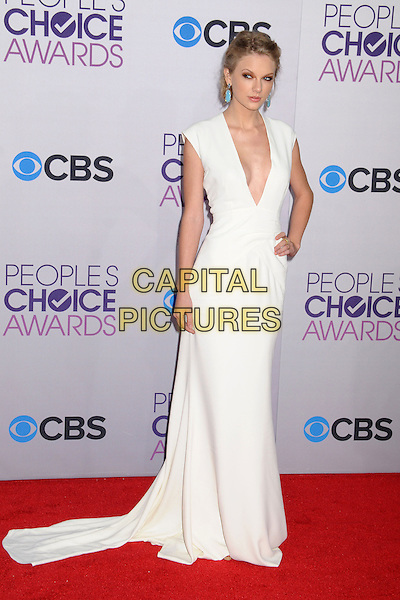 Taylor Swift.People's Choice Awards 2013 - Arrivals held at Nokia Theatre L.A. Live, Los Angeles, California, USA..January 9th, 2013.full length white dress plunging neckline cleavage hand on hip.CAP/ADM/BP.©Byron Purvis/AdMedia/Capital Pictures.