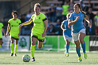 Seattle, WA - Sunday, April 17, 2016: Seattle Reign FC midfielder Kim Little (8) moves the ball passed Sky Blue FC midfielder Ashley Nick (10). Sky Blue FC defeated the Seattle Reign FC 2-1 during a National Women's Soccer League (NWSL) match at Memorial Stadium.