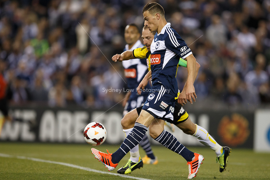 James TROISI of the Victory chips the keeper for his second goal in the round four match between Melbourne Victory and Wellington Phoenix in the Australian Hyundai A-League 2013-24 season at Etihad Stadium, Melbourne, Australia.<br /> This image is not for sale. Please visit zumapress.com for image licensing.
