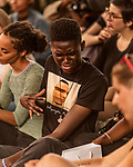 May 19, 2018. Durham, North Carolina.<br /> <br /> Yanju Elijah Aiyegbusi  reacts  while Moses Sumney plays the Cage at the American Tobacco Campus. <br /> <br /> Moogfest 2018 showcases 4 days of music, art and technology spread out amongst venues in and around downtown Durham.