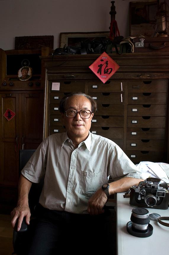 Chinese photographer Jiang Shaowu in him home in Shanyang.