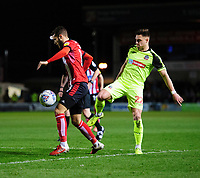 Lincoln City's Jorge Grant vies for possession with Bolton Wanderers' Ronan Darcy<br /> <br /> Photographer Chris Vaughan/CameraSport<br /> <br /> The EFL Sky Bet League One - Lincoln City v Bolton Wanderers - Tuesday 14th January 2020  - LNER Stadium - Lincoln<br /> <br /> World Copyright © 2020 CameraSport. All rights reserved. 43 Linden Ave. Countesthorpe. Leicester. England. LE8 5PG - Tel: +44 (0) 116 277 4147 - admin@camerasport.com - www.camerasport.com