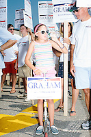 Supporters of Republican presidential candidate Lindsey Graham prepare to march in the Labor Day parade in Milford, New Hampshire.  Republican candidates John Kasich, Carly Fiorina, and Democratic candidate Bernie Sanders also marched in the parade.