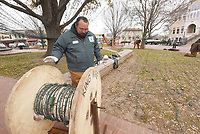 NWA Democrat-Gazette/FLIP PUTTHOFF<br />DOWN COME THE LIGHTS<br />Chris Kester with Bentonville Parks and Rereation packs up Christmas lights Tuesday Jan. 2 2017 on the Bentonville square. It takes a crew about two weeks to take down and pack away the miles of city Christmas lights, Kester said.