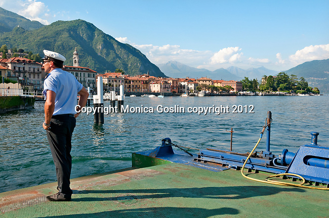 Car ferry sailor prepares as the boat arrives at the town of Menaggio on Lake Como, Italy